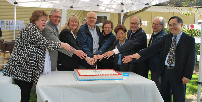 Dignitaries cut the cake at the 125th Steveston Post Office Celebrations