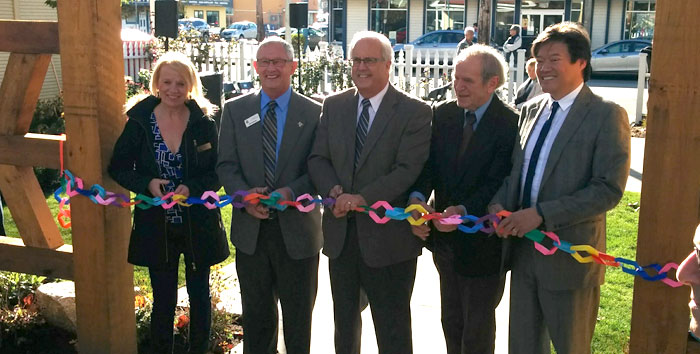 City officials cut the origami ribbon