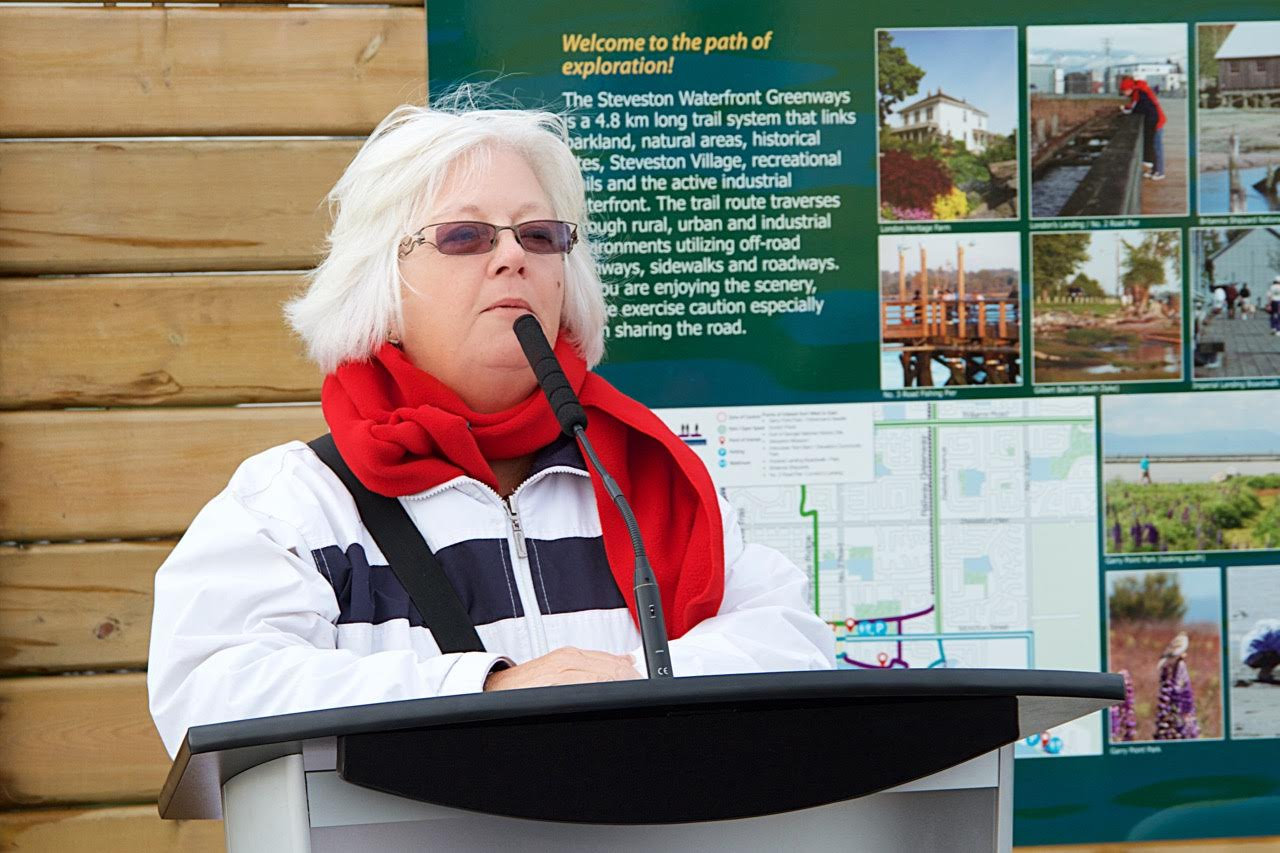 SHS Vice-Chair Linda Barnes speaks at the Mural Unveiling Event