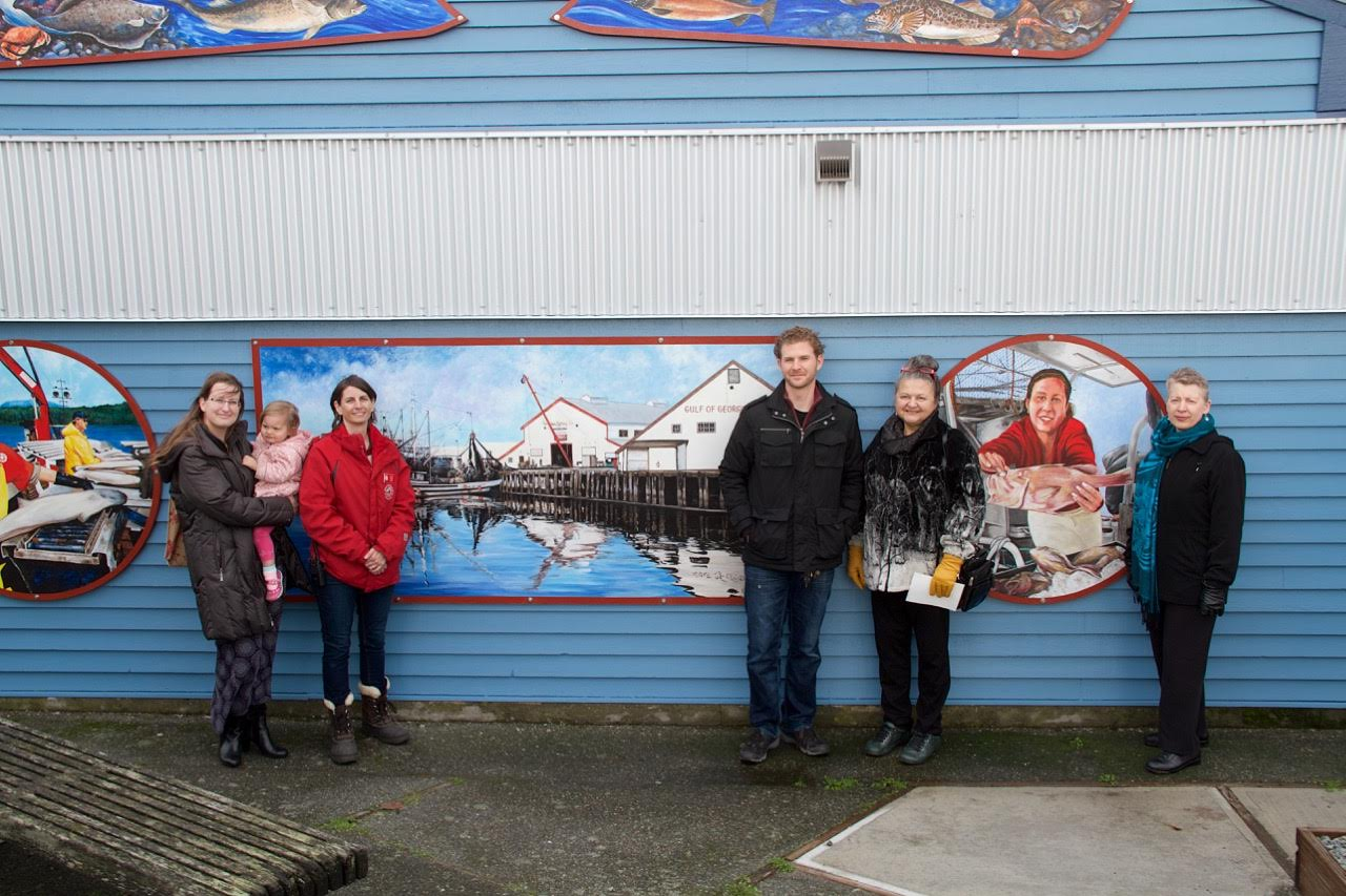 Project Steering Committee members in front of the completed mural