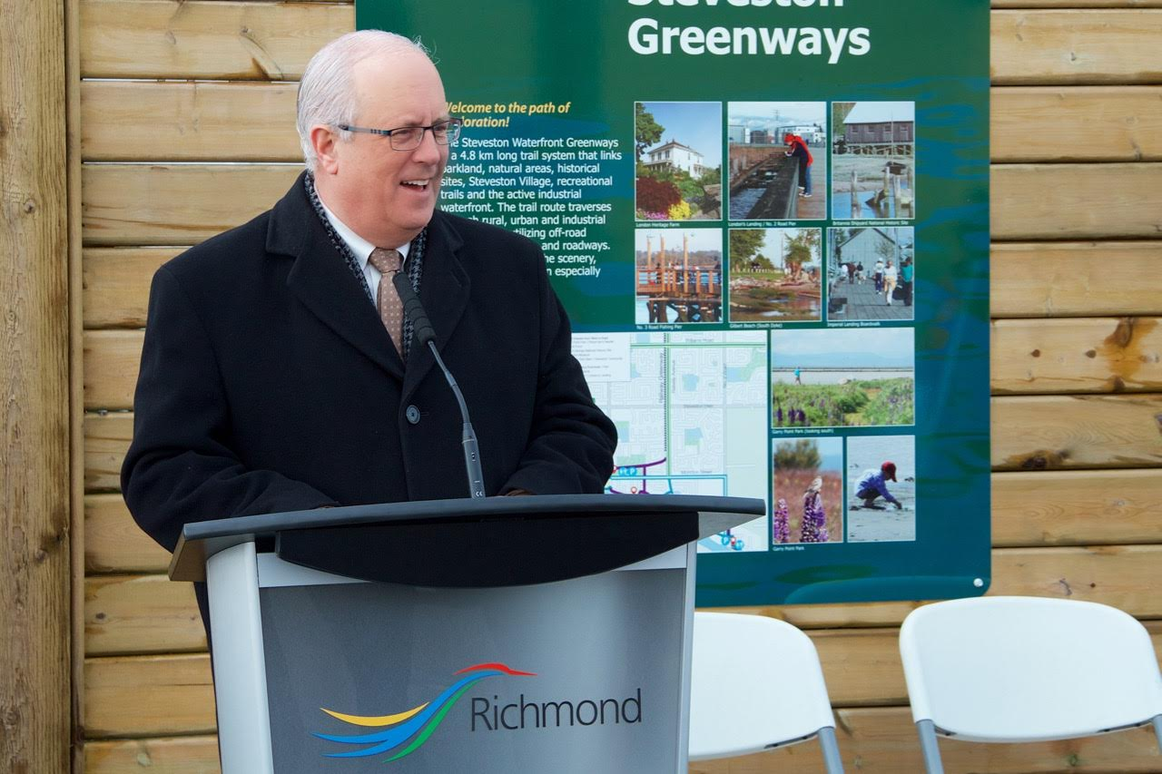 Mayor Malcolm Brodie speaks at the Mural Unveiling Event